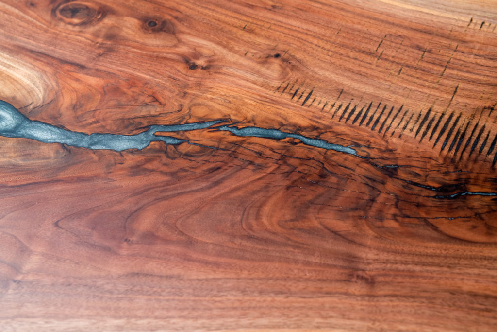 close up finished wood slab coffee table on display