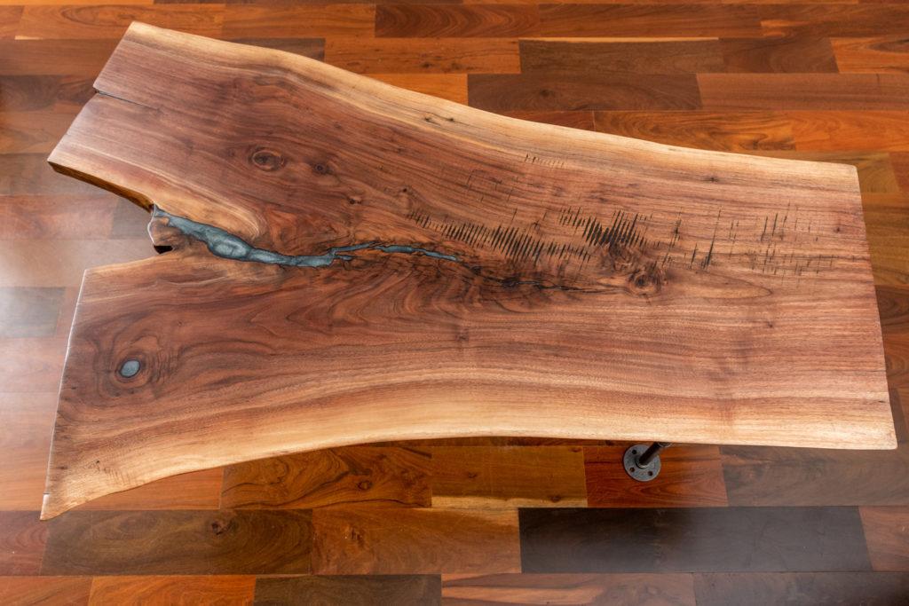 finished wood slab coffee table on display