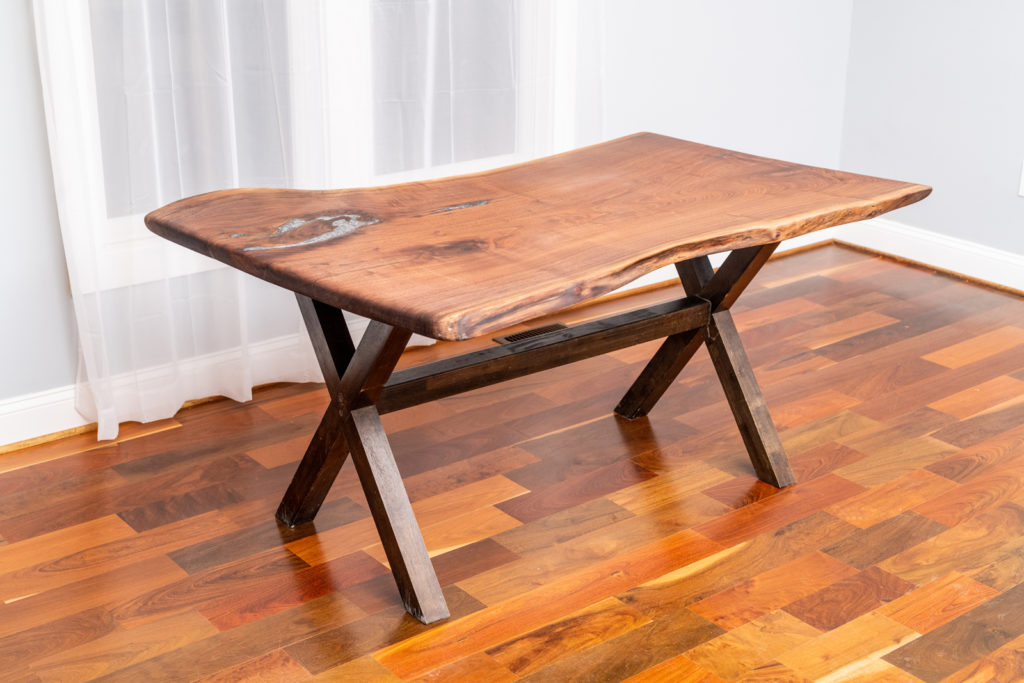 small finished wood slab table on display