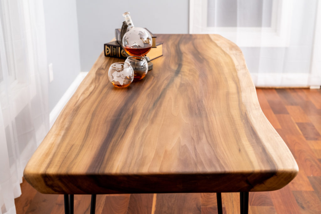 finished wood slab table on display in house