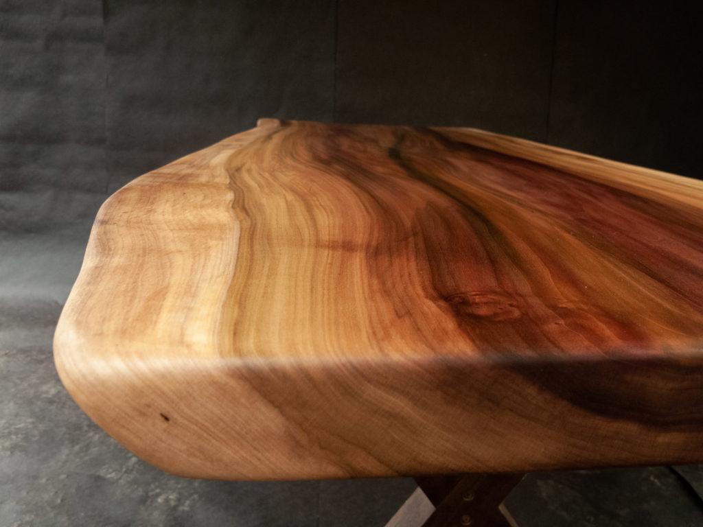 corner of finished wood slab table